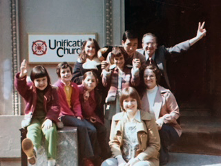unification church with peace signs