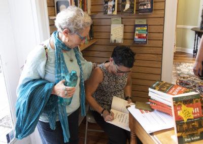 Lisa Kohn Signing- w Mom over shoulder